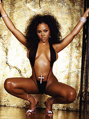 Pictures of Lil Kim in her various sexy outfits and a nipslip