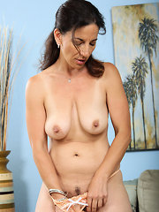 Big titted brunette shows us everything she has to show