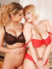 Playful busty Katarina & Sophie Mei stripteasing together