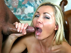 Perverted milf Lisa Demarco loves stroking massive boners. She jerks his prick feverishly, but when she can't seem to nut the milf gets mad and whacks his prick hard, moments later her face is splattered as he his cock erupts.