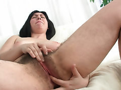 Natural Raven twists her hairy nipples