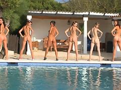 Young sexy talents train by the pool with their firm coach