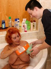 MILF asked her young lover to wash her back and she unzipped his pants while he was washing her and started blowing