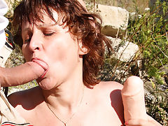 Hairy mature slut fucked in the open air