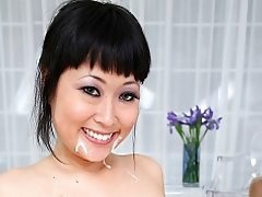 Japanese babe Yuki Mori goes down on a white cock