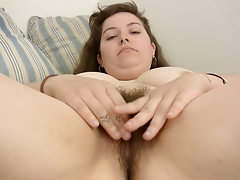 Curvy Esther fingers her bush
