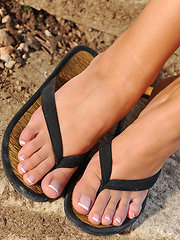 Stacy shows off her sexy feet and toes in flip flops
