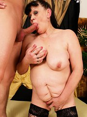 Kinky mama taking on a hard young cock