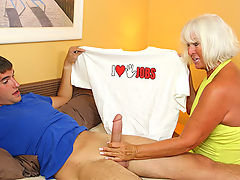 Grandma Jennie Lou catches Billys t shirt while doing laundry. The horny milf is excited by what it says and she decides to confront him. Jennie ends up giving the young lad a killer handjob when he nuts on himself.