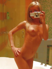 Tight teen blonde takes some hot mirror pics for her man