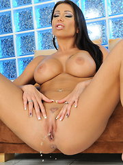 Big titted Candy stuffing a big dildo into herself