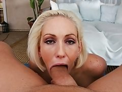 Busty blonde Kasey Grant gobbles a big cock