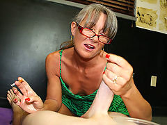 Sexy over 40 granny Leilani Lei is back and this time she is smoking while giving a nice gentle handjob to young Jonny he cums so hard he almost nuts on her cigarette.