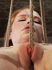 Madison Young hot natural red head, is suspended in a Category 5 tie. Two rope suspension, though her shaved pussy, made to suck cock!