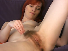 Sexy Leanne pulls on her pussy hair